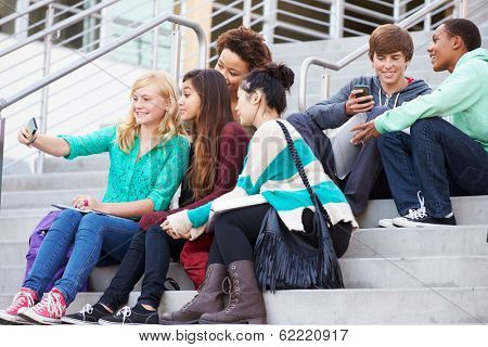 Group Of High School Students Taking Selfie Photograph