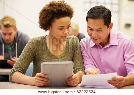 High School Student And Teacher Using Digital Tablet