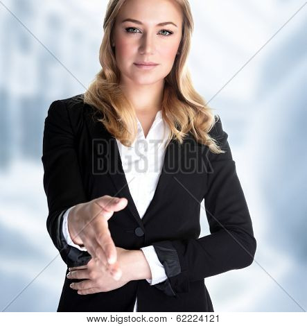 Closeup portrait of attractive business woman stretches out her hand for a handshake with partner, make a bargain, successful career concept