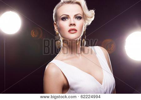 gorgeous blonde in white dress posing,  studio shot