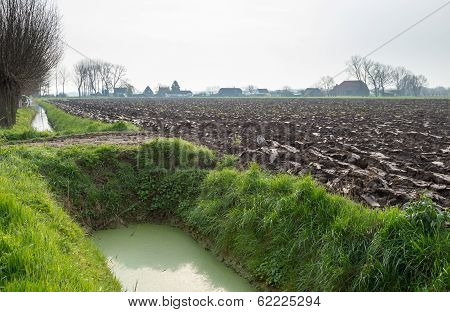 Recently Ploughed Field Next To A Ditch