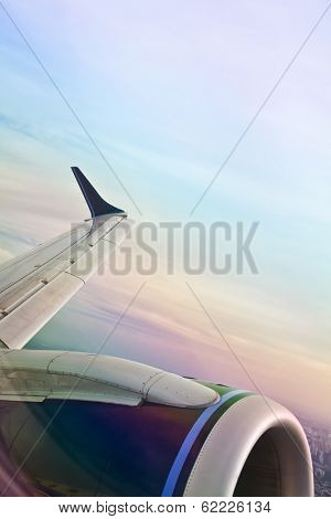 A view from an airplane window over the jet and wings.