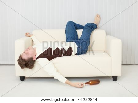 Drunkard Sleeps On Sofa In An Amusing Pose