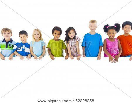 Group of Children Standing Behind Banner