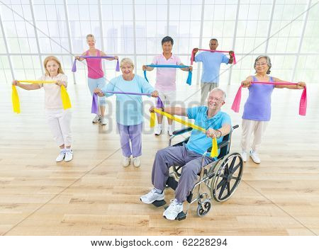 Group of Healthy Mature People and Wheelchair