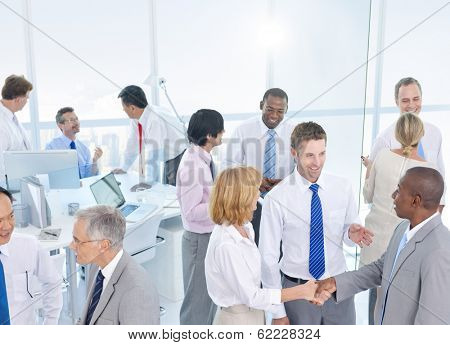 Group of Business People Shaking Hands in an Office