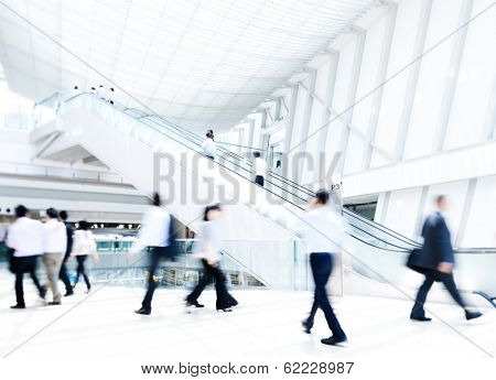 Business People Rushing in Office Building