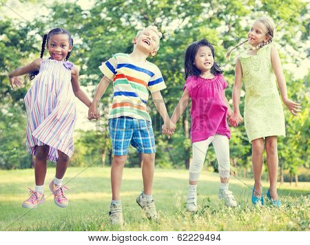 Diverse Children Jumping Together in a Park