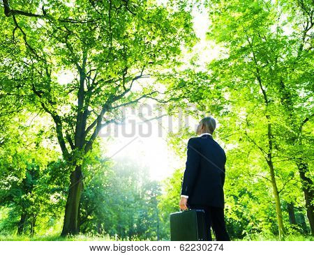 Environmentalist Businessman in Green Forest