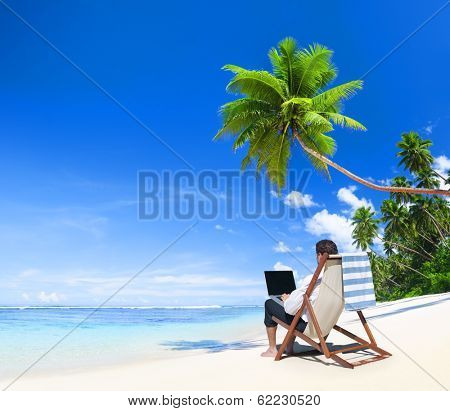 Businessman Working on laptop at Tropical Beach
