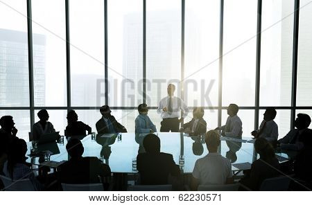 Leader Talking to Business Team at Meeting Table