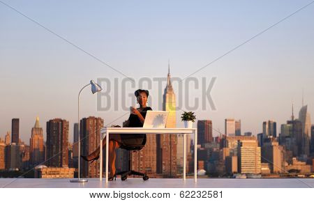 Businesswoman Having Morning Coffee at Outdoor Rooftop Office
