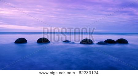 Tranquil and Peaceful View of Moreaki Boulders in Lake, New Zeland