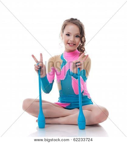 Cheerful little gymnast posing with mace