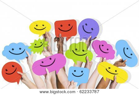 Hands Holding Smiley Faces Speech Bubbles