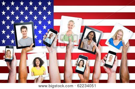 Multi-Ethnic Group Of Hands Holding Electronic Devices with American Flag