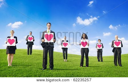 Business People Holding Hearts in Nature