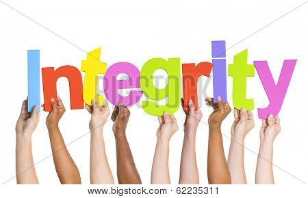 Multi-Ethnic Group Of People Holding The Word Integrity