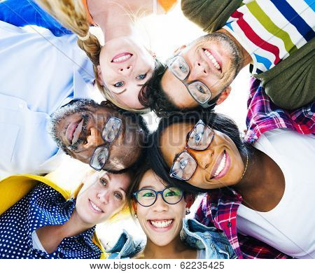Group of Diverse Colorful Friends With Their Heads Together