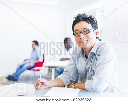 Cheerful Asian Businessman Working in Office