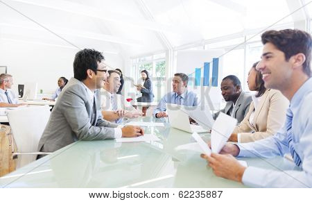 Group of Multi Ethnic Cheerful Corporate People Having a Business Meeting