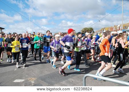 HASTINGS, ENGLAND - MARCH 23, 2014: Runners take part in the annual Hastings Half Marathon race at Hastings in East Sussex. This was the 30th year the event has been held.
