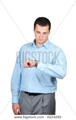 Handsome businessman checking his wrist-watch