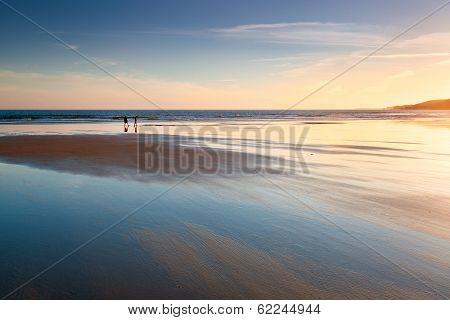 Sunset Reflections On A Tidal Beach