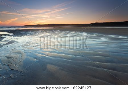 Rippled Sand Textures On A Low Tide Beach At Sunset