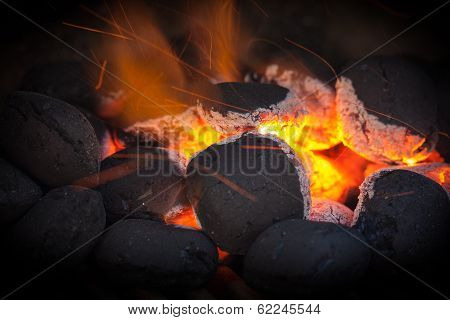 Charcoal Briquettes With Fire Sparks.black Vignette.