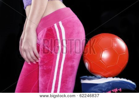 Young Girls Body With Soccer Ball Over Black Background