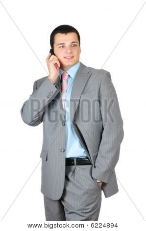 Businessman talking with cell phone isolated on white