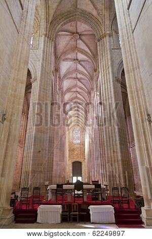 Batalha, Portugal - March 03, 2013: Batalha Monastery. Altar and Nave of the Church. Gothic and Manueline masterpiece. Portugal. UNESCO World Heritage Site.