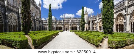 Batalha, Portugal - July 17, 2013: Royal Cloister of the Batalha Monastery. A masterpiece of the Gothic and Manueline art. Portugal. UNESCO World Heritage Site.