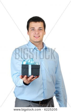 Young man holding present box isolated on white