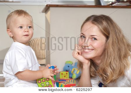 Young Mother Plays With Her Son