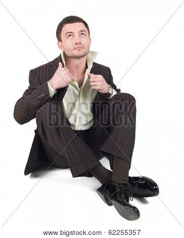 Young businessman sitting in black business suit and shirt isolated at white background