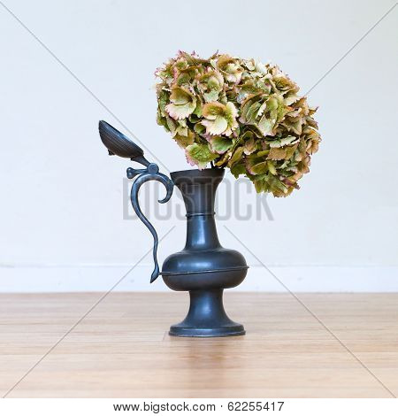 Flowers In An Old Tin Vase