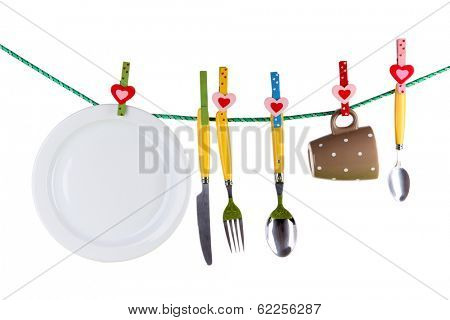 Tableware dried on rope isolated on white
