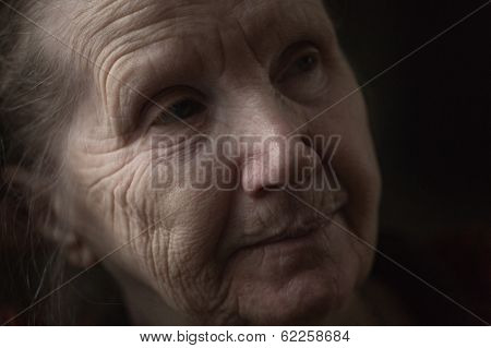 Old Woman Thinking In The Dark