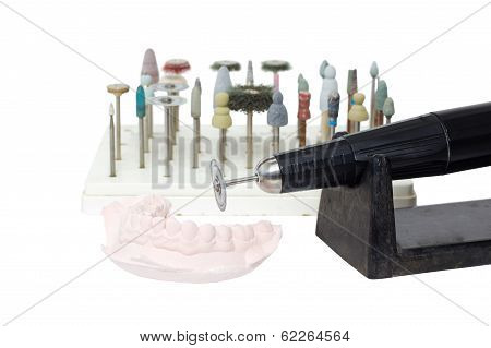 Old Grunge Micromotor Dental Lab And Mould Of Teeth