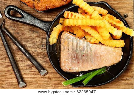 Sashimi Tuna and Chips in Skillet on Table at home or restaurant.