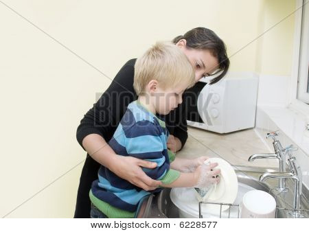 Mother and Son washing dishes.