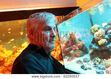 Senior Man At Oceanarium