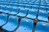 foto of grandstand  - Empty plastic chairs of blue color on stadium grandstand  - JPG