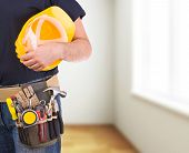pic of blue-collar-worker  - Image of a blue collar worker with tool belt - JPG