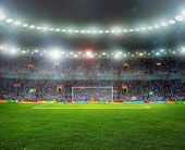 stock photo of pole  - Soccer ball on the field of stadium with light - JPG