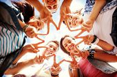 summer holidays and teenage concept - group of teenagers showing finger five gesture