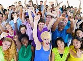 stock photo of arms race  - Large Group of People Celebrating - JPG