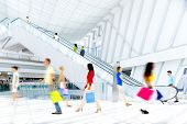 stock photo of elevator  - Motion Blurred People in the Shopping Mall - JPG